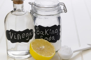 Vinegar and baking soda with a half a lemon
